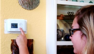 Sara adjusts her ecobee Smart Thermostat at home